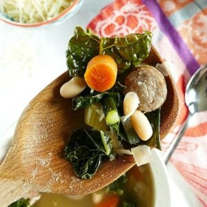 Easy and delicious slow cooker kale and white bean soup with sausage. Gluten-free and filled with vegetables!