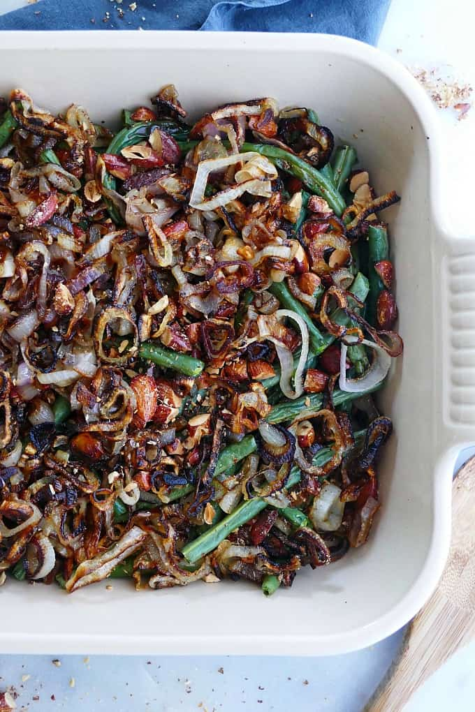 close up of green bean casserole with crispy shallots and almonds