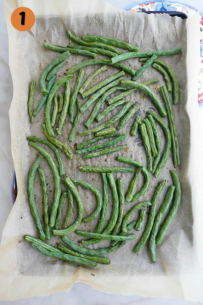 green beans on a baking sheet lined with brown parchment paper