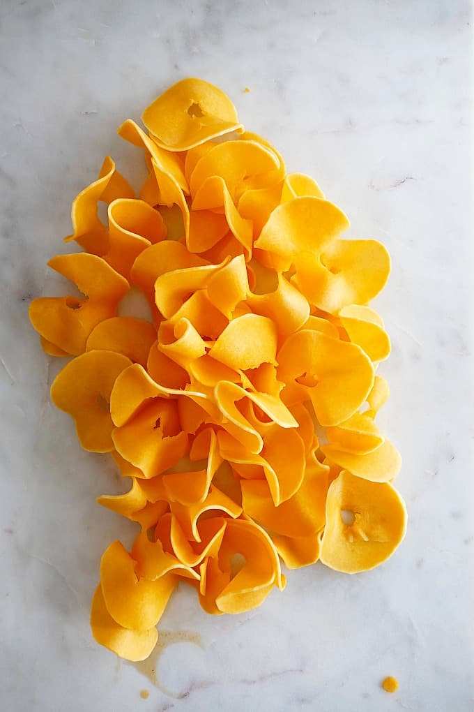 thick butternut squash noodles on a white marble countertop