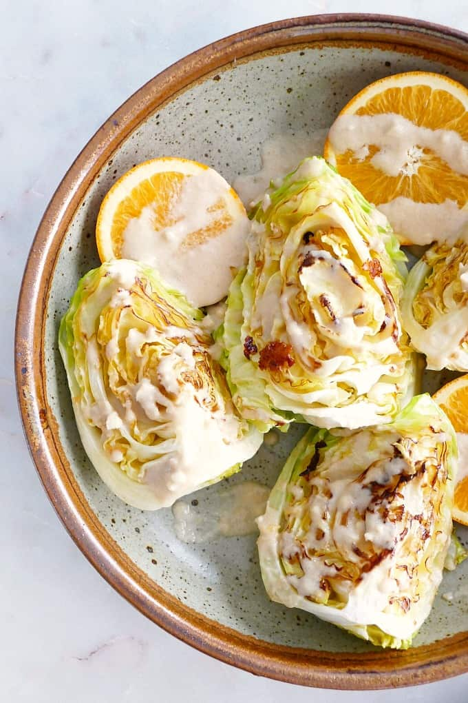 close-up of seared cabbage wedges with tahini dressing