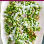 peas and cheese on a pink serving tray with a purple text box containing the recipe name