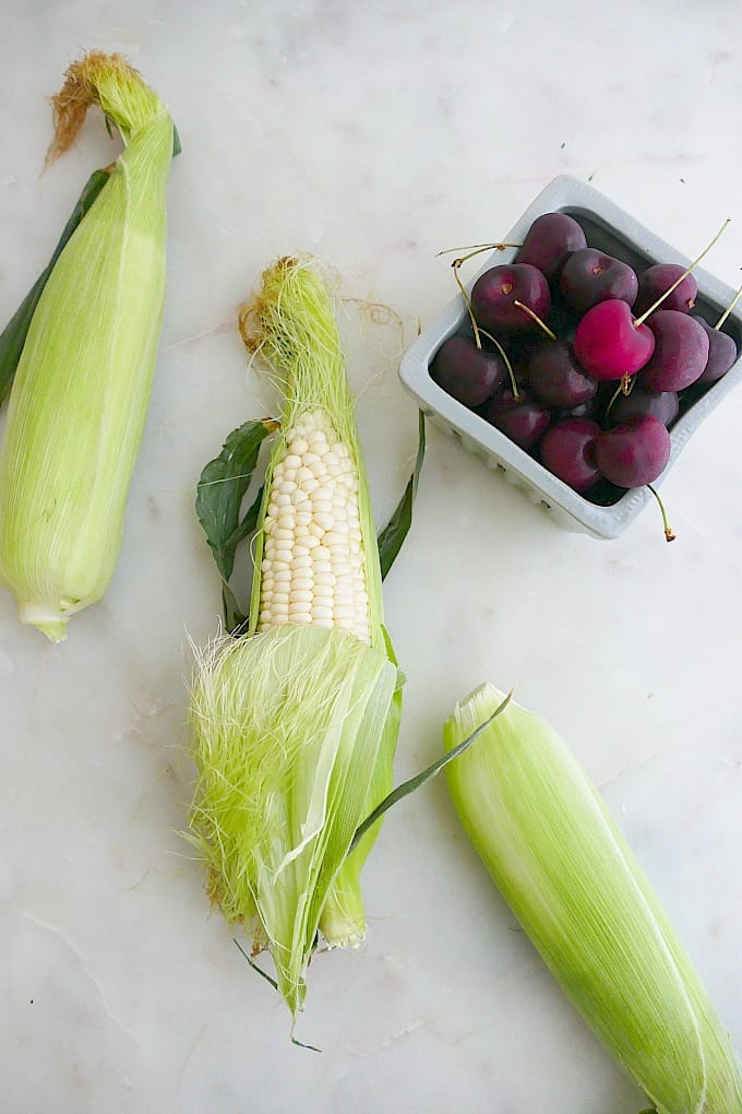 corn husks and cherries