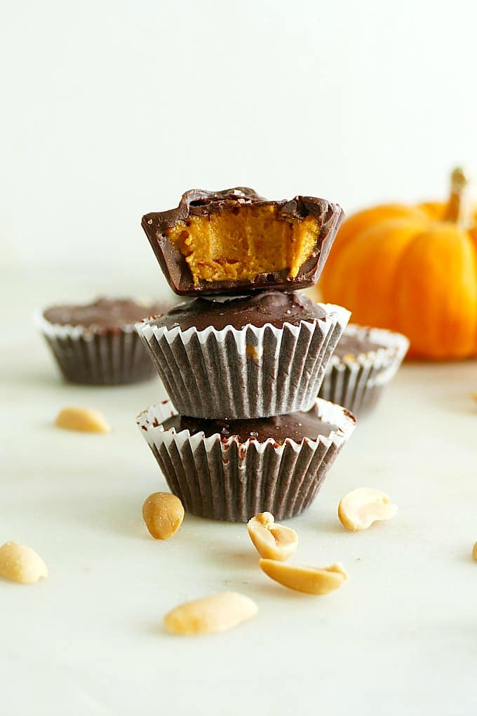three pumpkin peanut butter cups stacked on each other