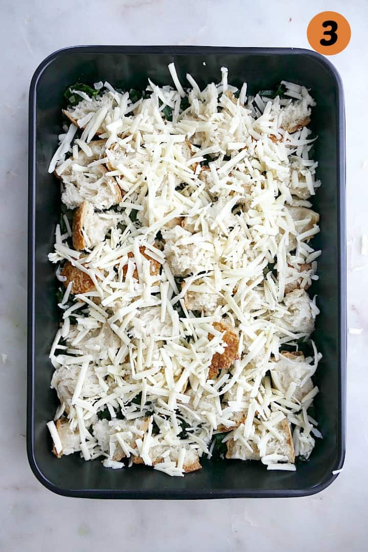 kale, shallots, sourdough bread cubes, and shredded cheese in a 9x13 baking dish