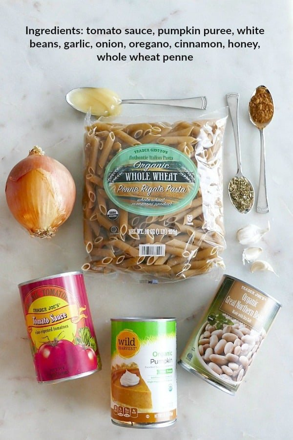 Ingredients for pumpkin tomato pasta with text overlay