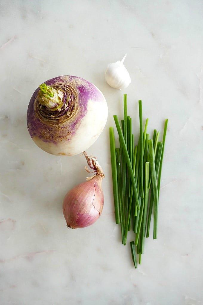 a turnip, shallot, garlic clove, and chives