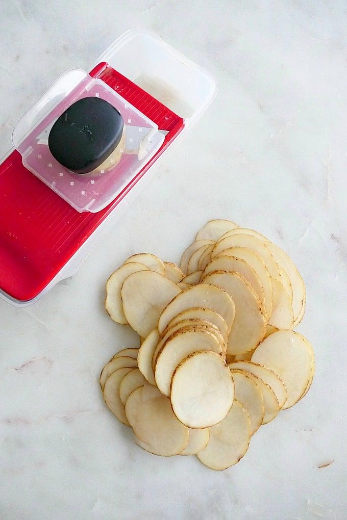 mandoline with sliced potatoes