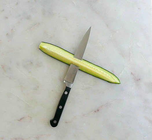 cucumber with a knife in it