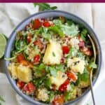image of quinoa, arugula, and pineapple salad with a purple text box at the top