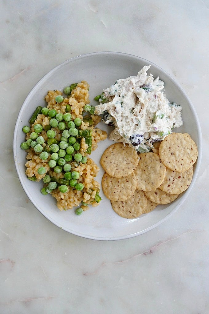 plate with vegetable risotto, chicken salad, crackers
