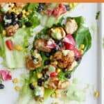 healthy southwest chicken lettuce wrap on a platter with a text box on top
