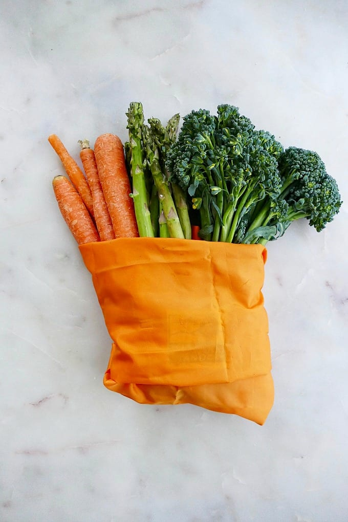 carrots, asparagus, and broccoli in produce bag