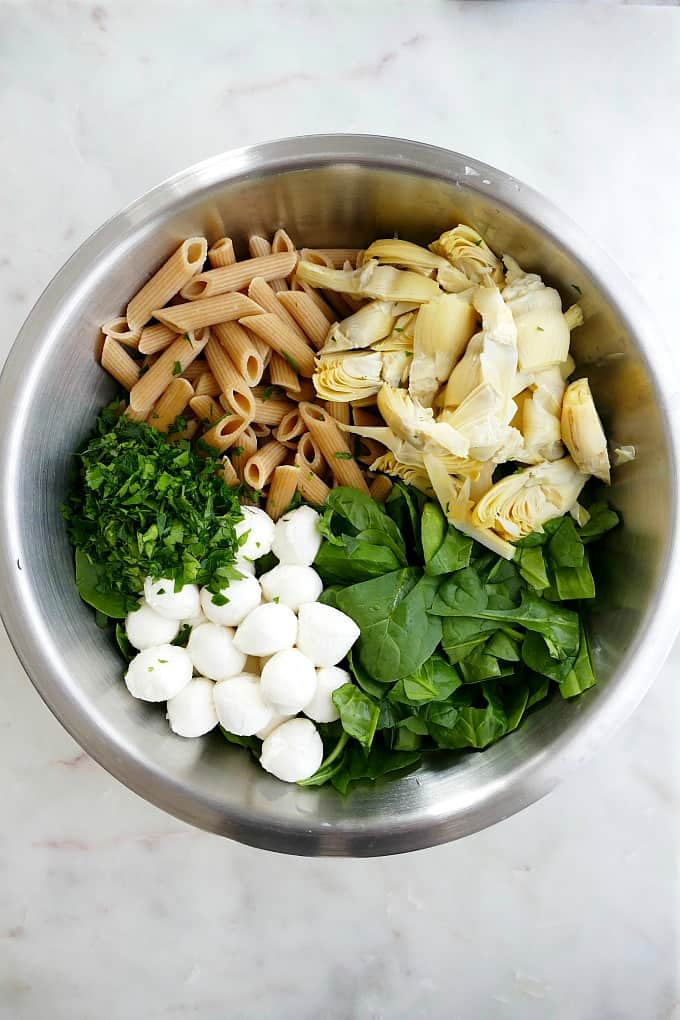 ingredients for the recipe next to each other in a mixing bowl