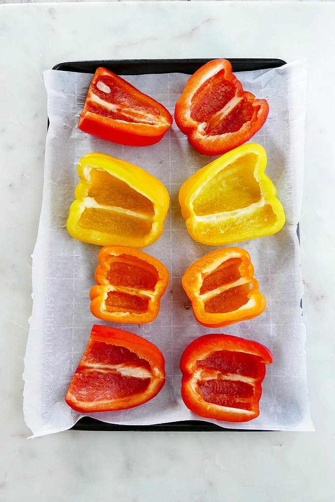 sliced peppers on a sheet pan