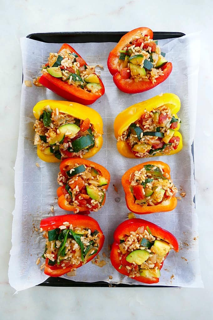 stuffed peppers on a baking sheet