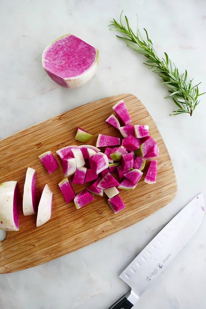 watermelon radishes diced on a cutting board
