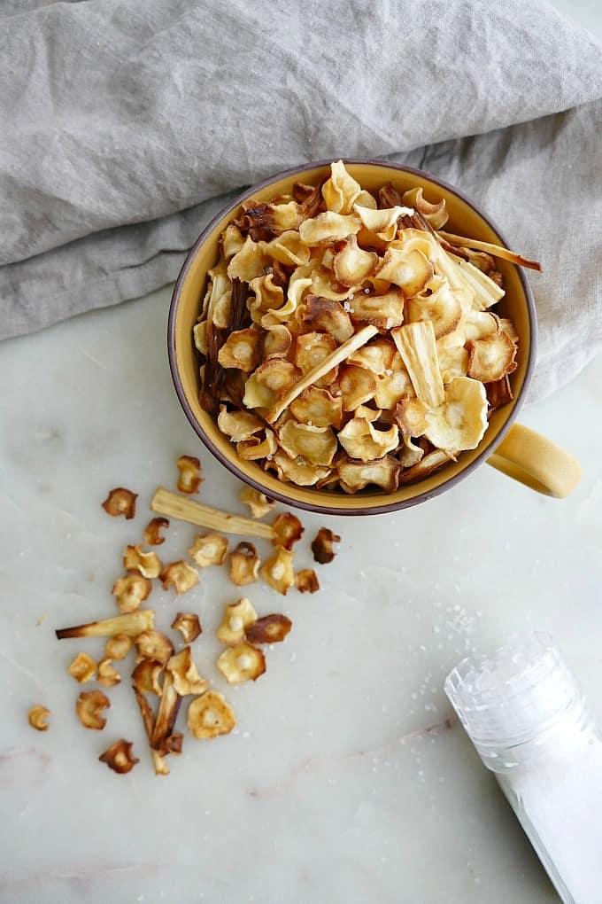 baked parsnip chips in mug