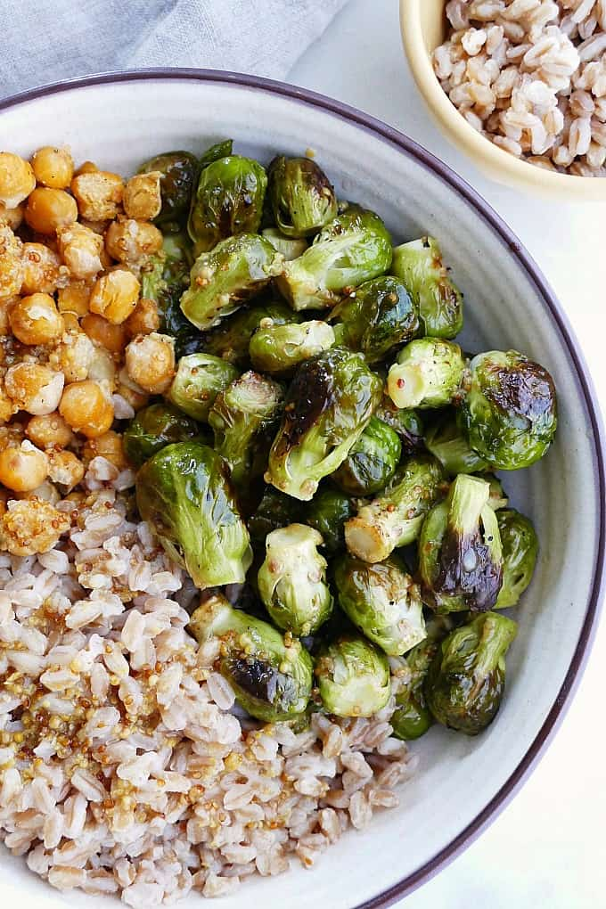 honey mustard brussels sprouts and chickpeas bowls close-up