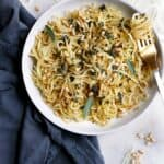 kohlrabi noodles and pine nuts in a bowl