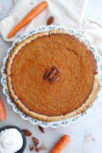 close up of homemade carrot pie in a baking dish on a counter