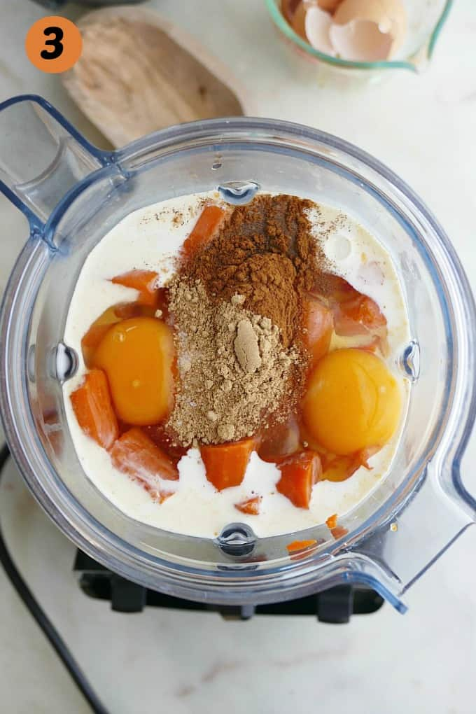 cooked carrots, cream, eggs, spices, and maple syrup in a blender