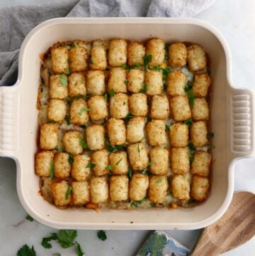 healthy tater tot casserole on a gray napkin on countertop