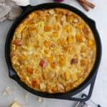 apple pumpkin frittata with gouda in a black skillet on a countertop