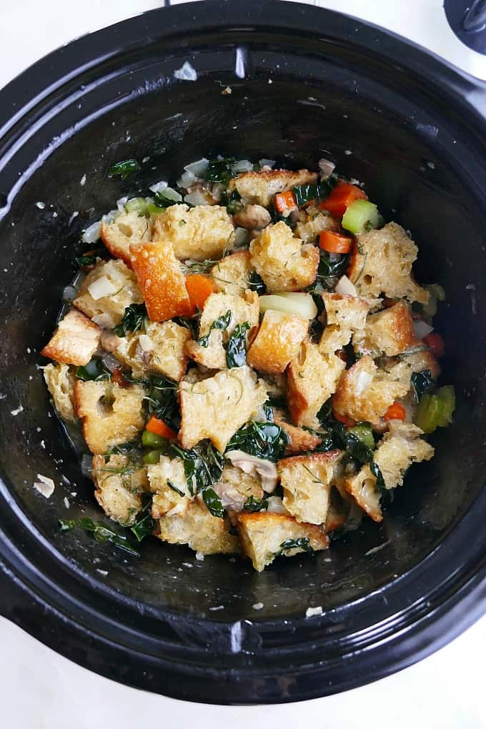 vegetable stuffing in a black crockpot before being cooked