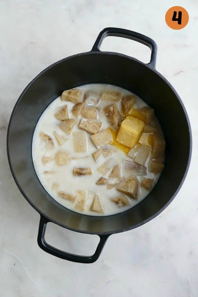 celery root, milk, and butter in a black pot with the number 4