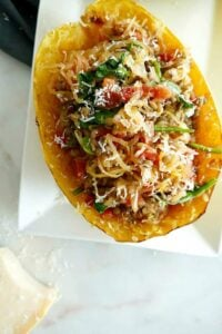 close-up of italian spaghetti squash stuffed with spinach and lentils on a plate