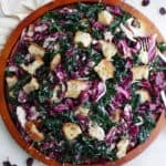 kale radicchio salad with sourdough croutons on a large wooden platter