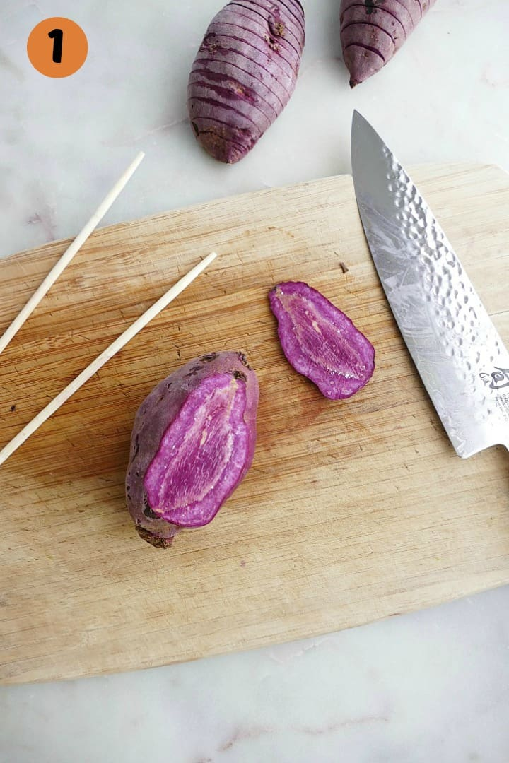purple sweet potato on a bamboo cutting board next to a sharp knife