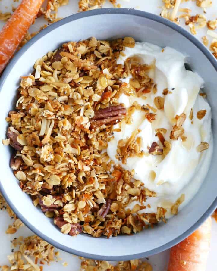 blue bowl with carrot cake granola and plain yogur