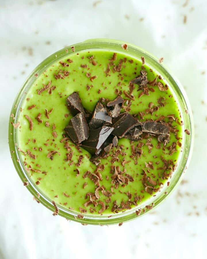 green drink in a glass with shaved chocolate on top