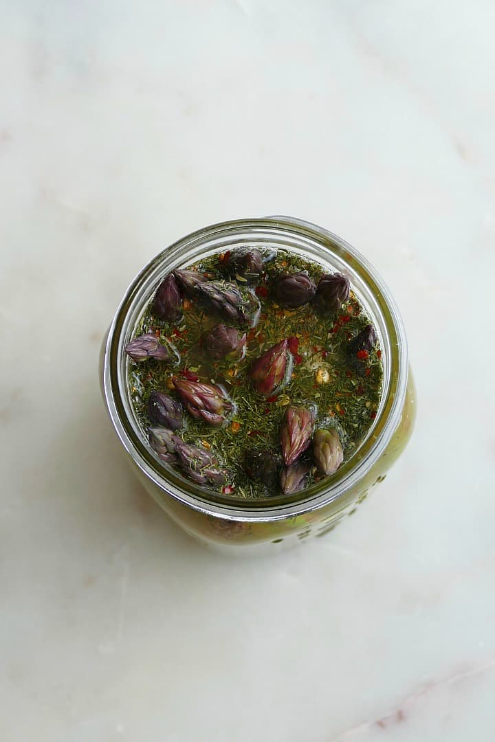 overhead shot of asparagus in a jar with pickle brine and dill