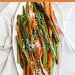 roasted asparagus and carrots on an oval tray with an orange text box
