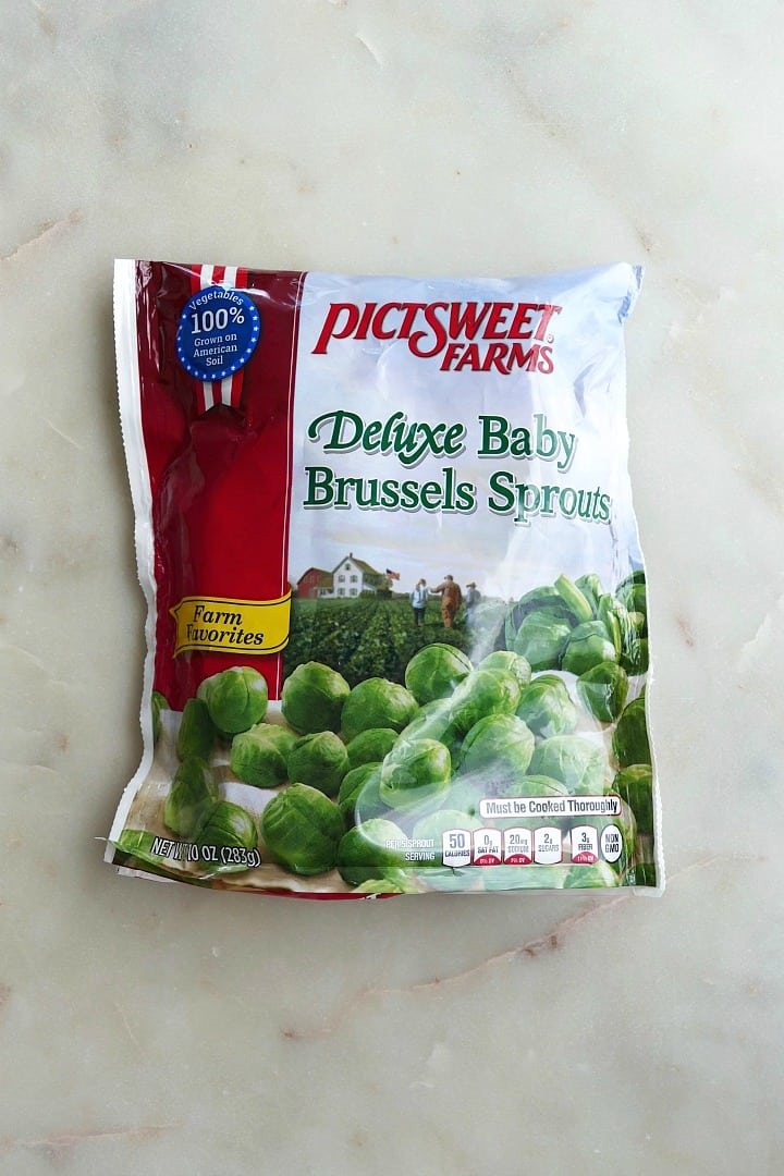 bag of frozen baby brussels sprouts on a white counter