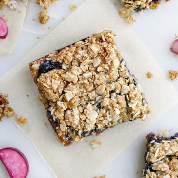 blueberry rhubarb crumb bars spread out on a counter