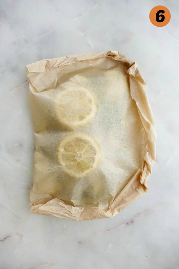 parchment paper packet for fresh cod with lemon and vegetables
