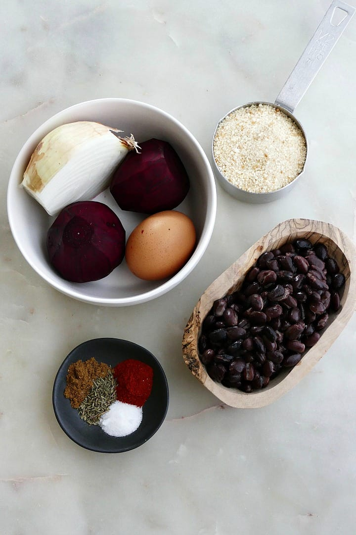 bowls with ingredients for beet burgers next to each other on a counter