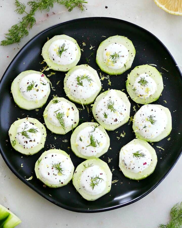 square image of cucumber canapes topped with whipped feta and dill