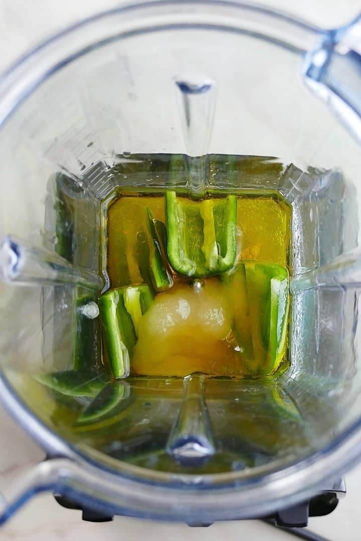 jalapeno, olive oil, and honey in a vitamix blender on a counter