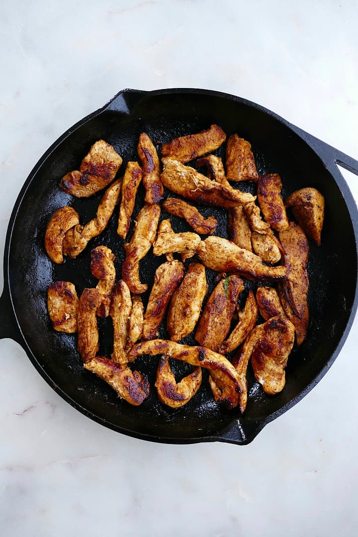 fajita chicken in a cast iron skillet on a counter