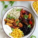 image of chicken fajita bowl with an orange text box with recipe title
