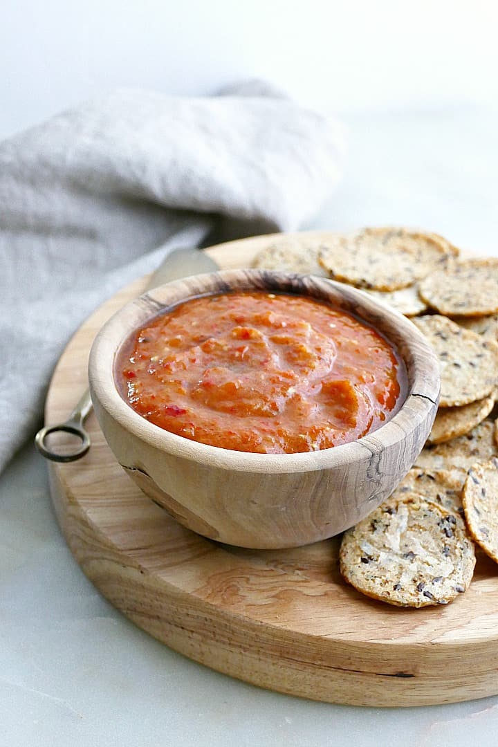side view of eggplant red pepper dip on a serving platter