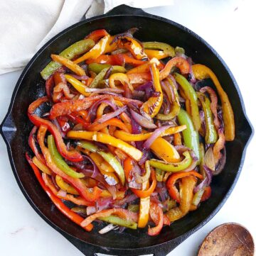 square image of fajita veggies in a cast iron skillet on a counter