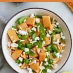 melon and sugar snap pea salad with a text box on top with the recipe title