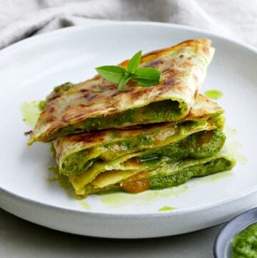 square image of spinach basil pesto quesadillas on a plate