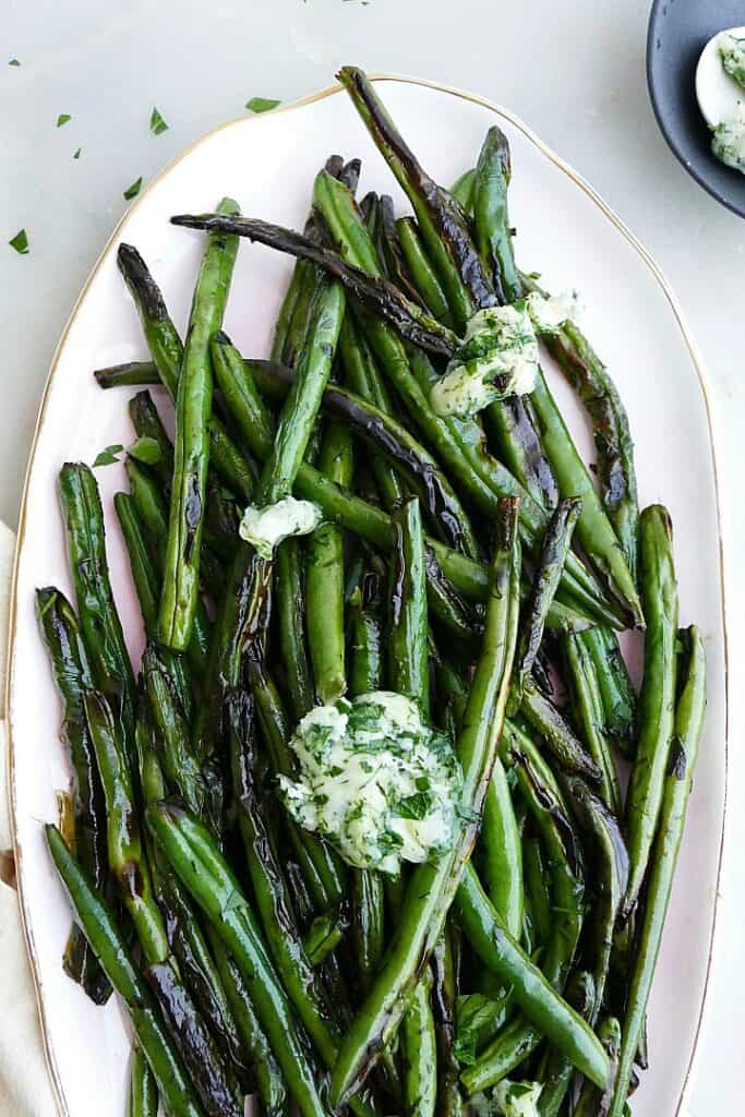 close-up of garlic butter green beans on a serving platter